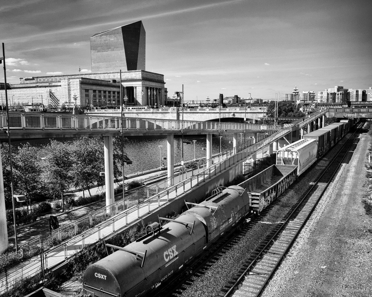 transportation, rail transportation, railroad track, architecture, built structure, train - vehicle, mode of transport, public transportation, sky, bridge - man made structure, no people, shunting yard, building exterior, day, outdoors, water, commuter train, city