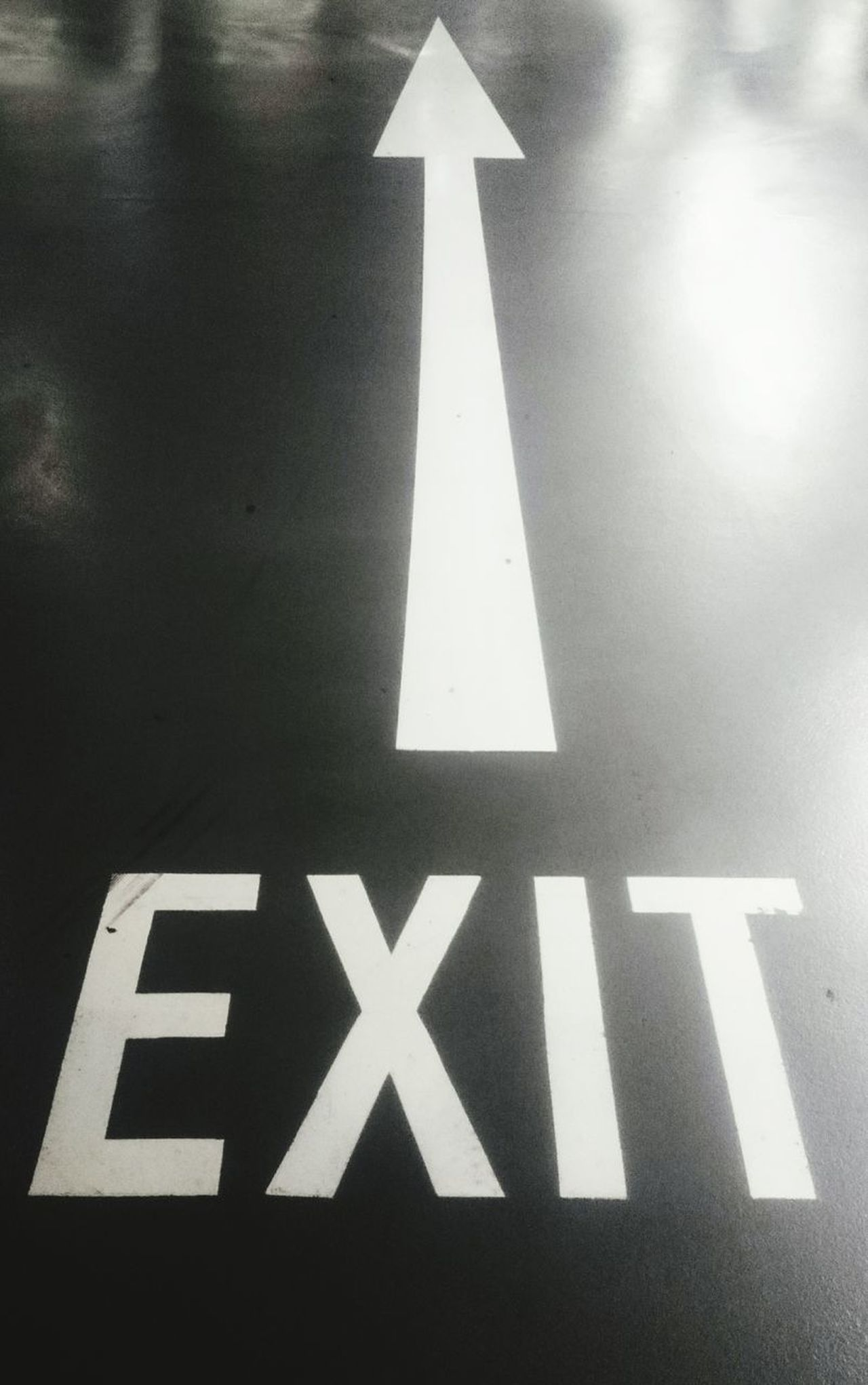 Direction arrow with exit sign on the road. Arrow Symbol Guidance Direction Communication Transportation No People Arrow Sign Arrow Asphalt Black Directional Sign Direction Exit Exit Sign Forward LINE Path Perspective Road Sign Street Urban Way Black And White
