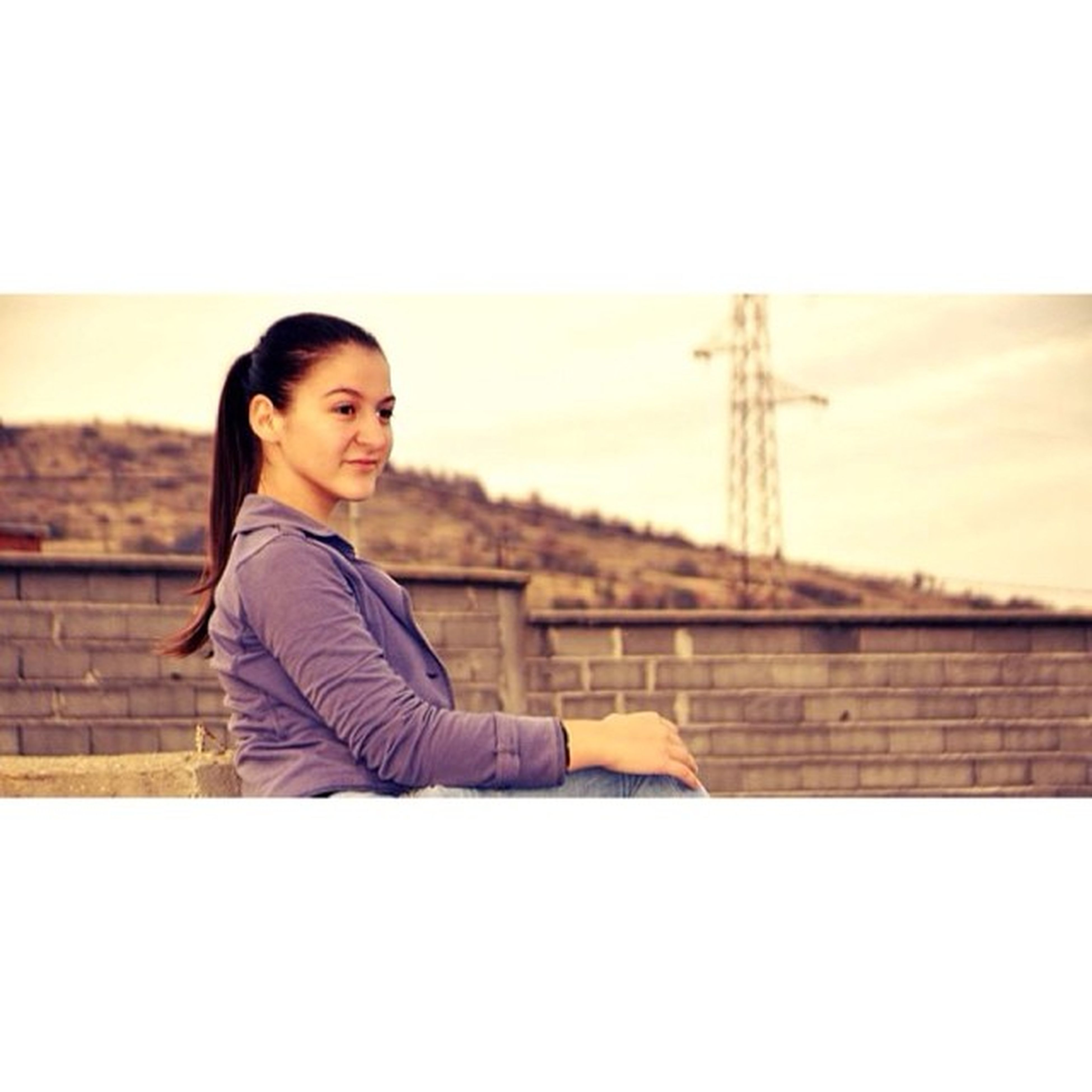 young adult, casual clothing, lifestyles, person, portrait, looking at camera, standing, leisure activity, young women, waist up, sitting, front view, three quarter length, railing, smiling, clear sky, copy space, full length