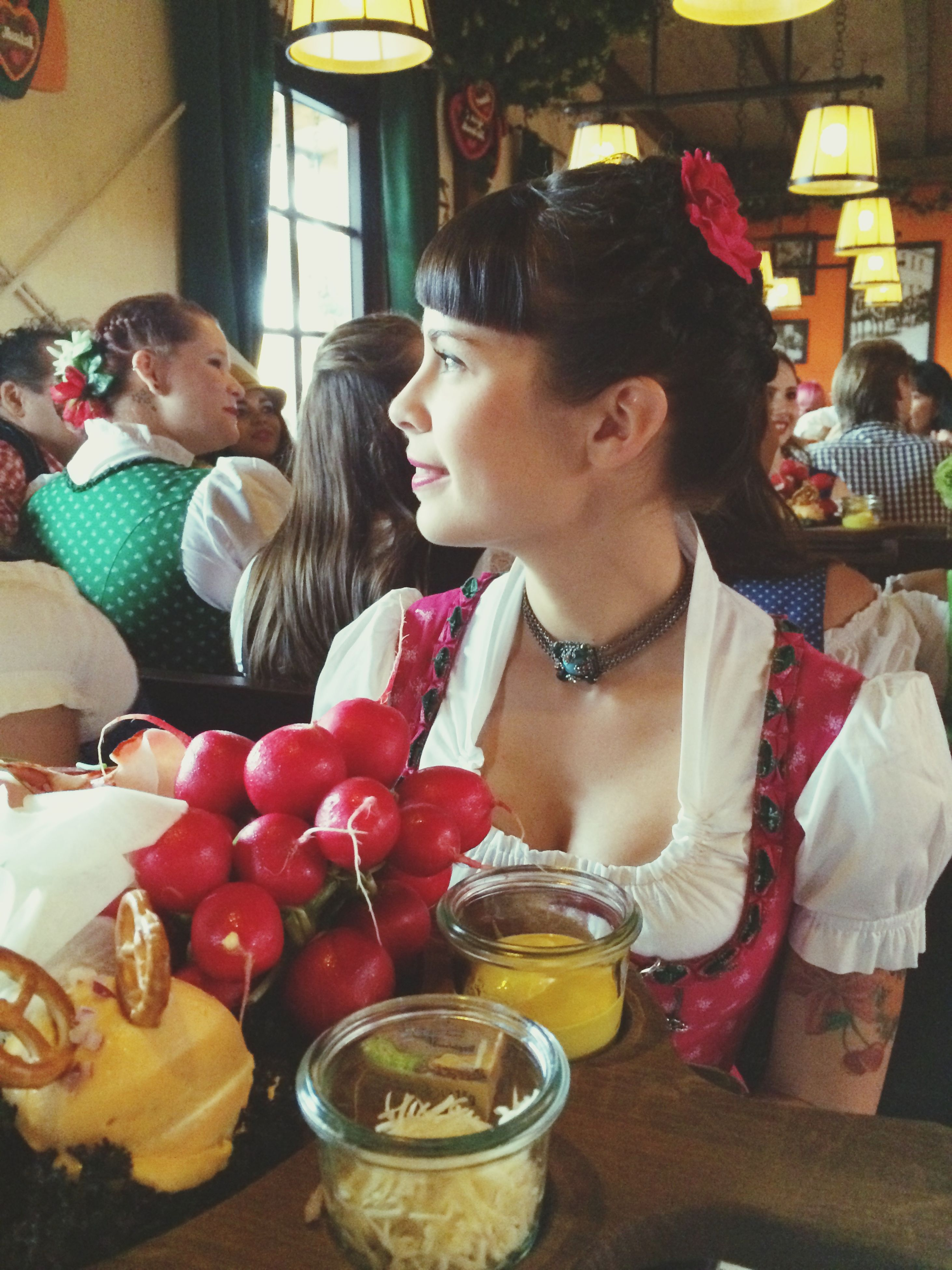 indoors, person, lifestyles, casual clothing, sitting, leisure activity, looking at camera, food and drink, portrait, table, home interior, young adult, front view, smiling, restaurant, waist up, food, happiness