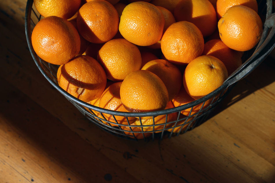 Fresh oranges in a basket in the afternoon sunlight Basket Citrus Fruit Close-up Day Food Food And Drink Freshness Fruit Fruits Fuit Healthy Eating High Angle View Indoors  No People Orange Orange - Fruit Orange Color Oranges Sunlight