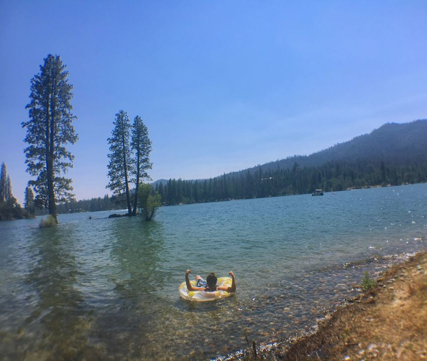 home away from home Tree Water Nature Day Beauty In Nature Leisure Activity River Outdoors Sky Tranquility Scenics Real People Inflatable Raft Sitting Mountain Clear Sky Lifestyles Nautical Vessel Bass Lake, California Yosemite National Park Inner Tube Floating On Water
