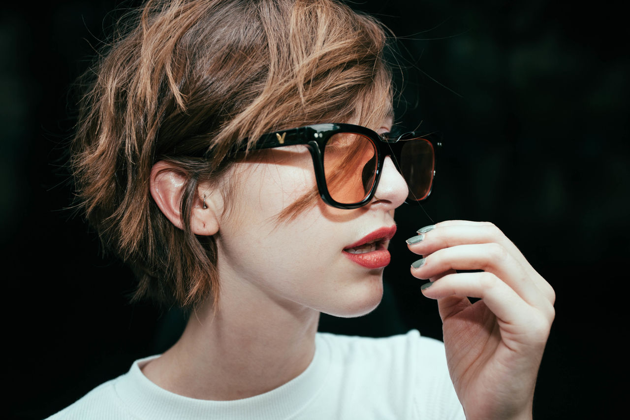 Beautiful Woman Black Background Childhood Close-up Day Eyeglasses  Headshot Leisure Activity Lifestyles One Person Outdoors People Portrait Real People Young Adult Young Women