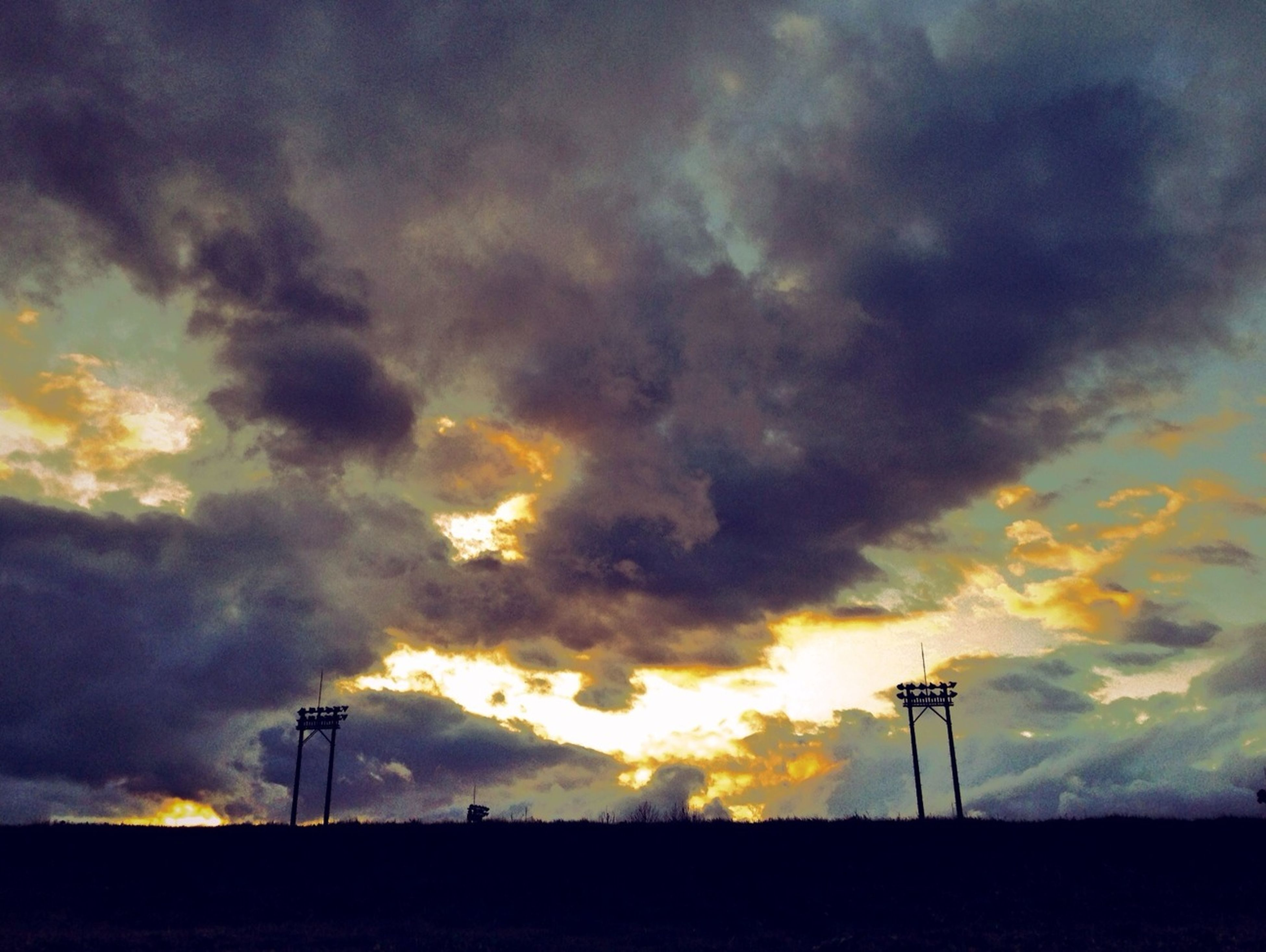 sunset, silhouette, sky, fuel and power generation, wind turbine, wind power, cloud - sky, landscape, alternative energy, windmill, environmental conservation, field, tranquil scene, renewable energy, scenics, dramatic sky, beauty in nature, cloudy, tranquility, technology