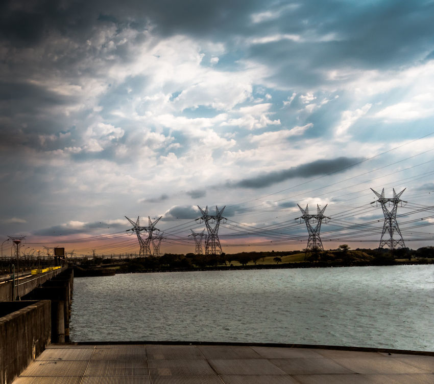 Electrical Towers Eletricity River Sky With Clouds Sunset