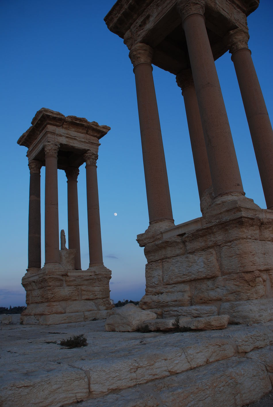 2009 Ancient Ancient Civilization Archaeology Architectural Column Architecture Before War Blue Built Structure Clear Sky Day History Monument No People Old Ruin Outdoors Palmyra Roman Architecture Roman Ruins Ruined Syria  Tetrapylon The Past Tourism Travel Travel Destinations