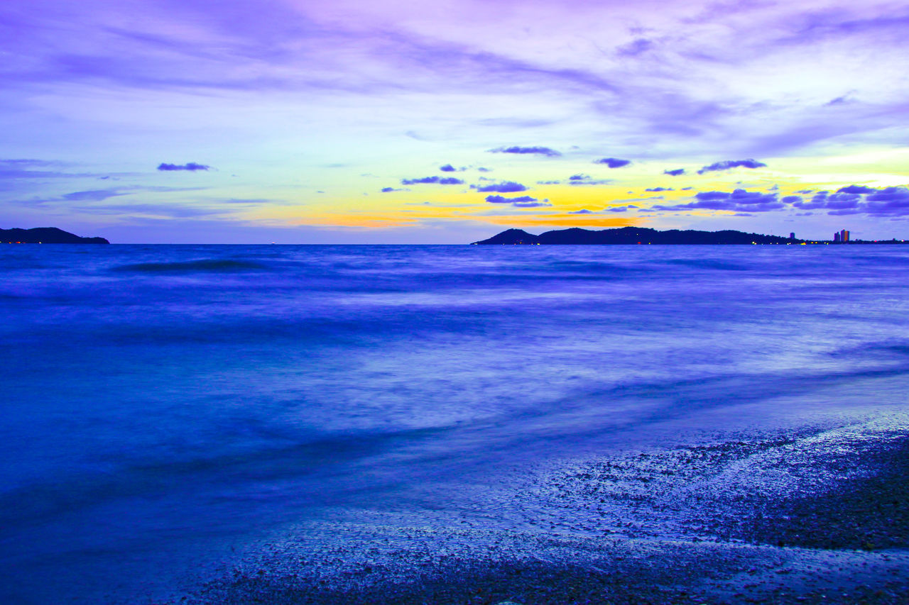 Beautiful sunset in evening at the sea Thailand. Sea Beach Sunset Scenics Wave Softwaves Seascape Multi Colored Dramatic Sky Ocean Nature Beauty In Nature Landscape Outdoors Cloud - Sky Thailand Travel Water Blue No People Beauty Island Weather Season  Tourism