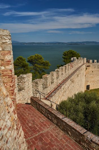Fortress of the Lion, Castiglione del Lago, Umbria Italy Umbria Castiglione Del Lago Lago Trasimeno Lake Lake View Blue Sky Fortress Fort Fortress Wall Wall Architecture Historic Historical Building Travel Destinations Ancient Steps Outdoors No People Nature Medieval Trees