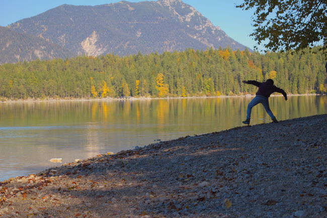 Skipping stones makes so much fun!;) Adult Beauty In Nature Day Full Length Horizontal Lake Landscape Leisure Activity Motion Mountain Nature Nature One Man Only One Person Only Men Outdoors People Person Reflection Scenics Tree Trees Water Water Reflections Waterfront