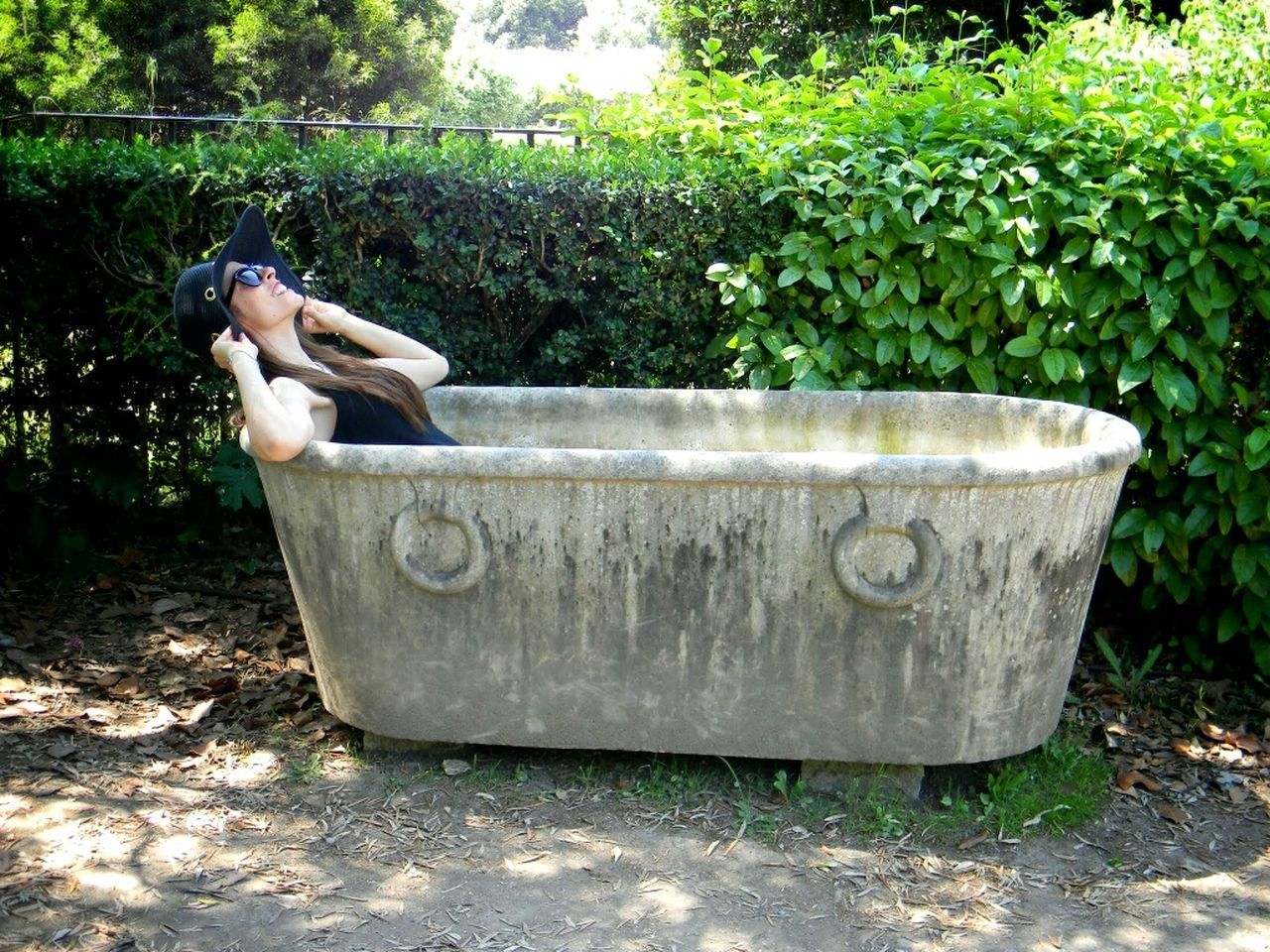 Young women in ancient Roman bathtub in Italy Rome Rome Italy Italy Travel Destinations Europe Model Smile Happiness Fun Wanderlust One Person