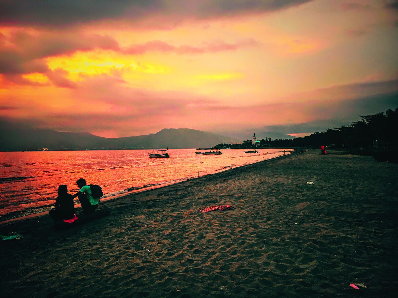 Sunset lovers in Subic Eyeem Philippines TravelPhilippines EyeEm Nature Lover Sky Sunset Water Beauty In Nature Scenics Mountain Nature Cloud - Sky Outdoors Nautical Vessel Sea Tranquil Scene Beach Real People Tranquility Men Togetherness Day People