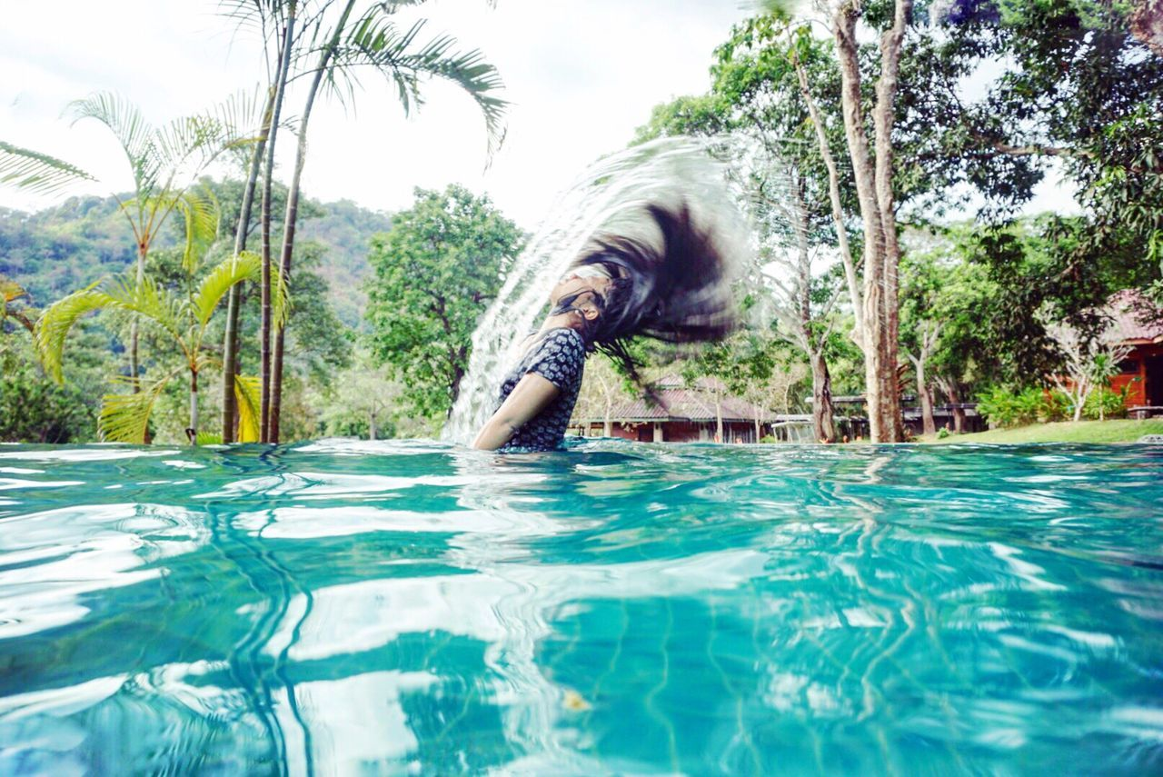 One Person One Woman Only Water Vacations Holding Leisure Activity Happiness Outdoors Young Women Pool Swmming Action Shot  Water Reflections Swing Move Asain