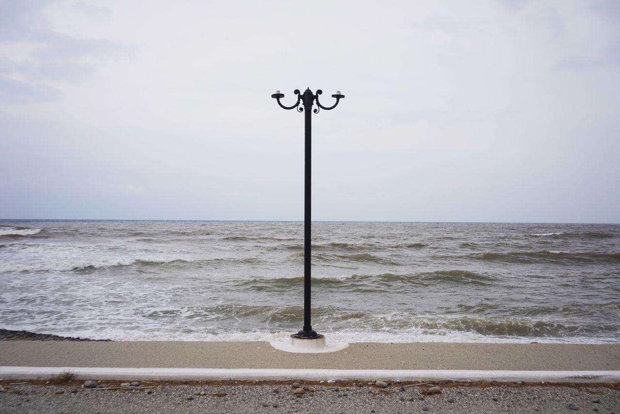 beach illumination broken sky grey sea outdoors no people