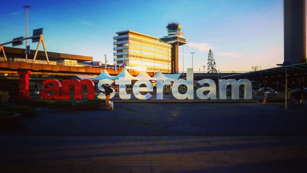 Amsterdam, Holland. City Text Transportation Travel Architecture No People Sky Bridge - Man Made Structure Outdoors Illuminated Skyscraper Clock Face Day The City Light Amsterdam Holland Amsterdam City Amsterdamlife Iamamsterdam EyeEmNewHere
