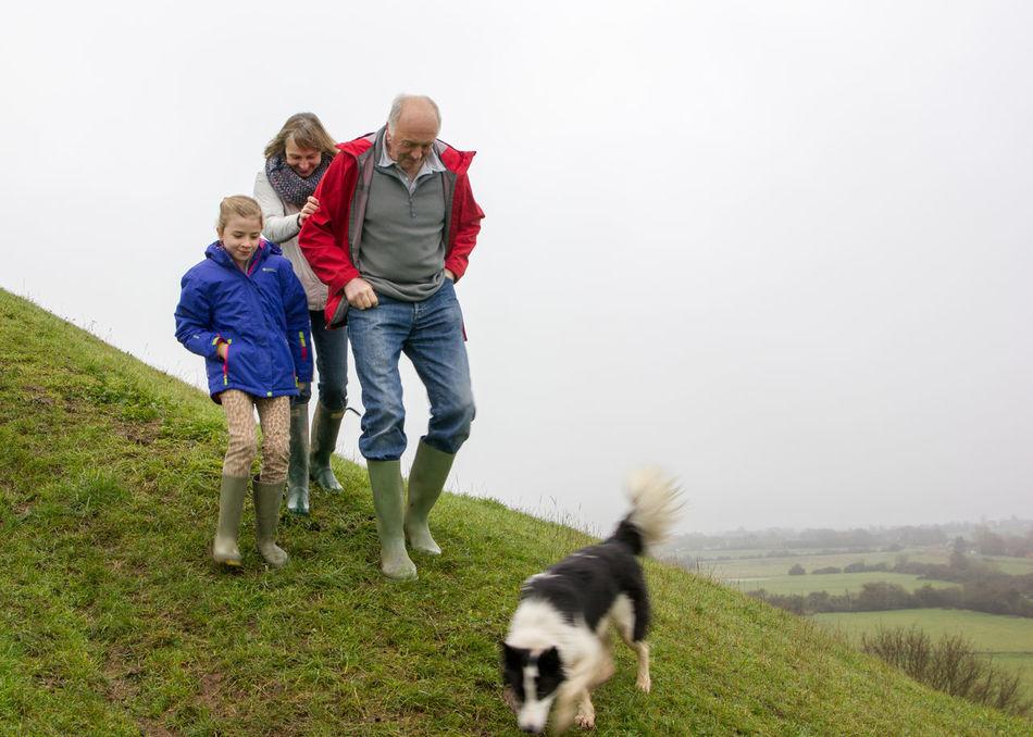 Bonding Child Childhood Dog Family Full Length Leisure Activity Pets Steep Steep Hill Togetherness Walk Walking Around