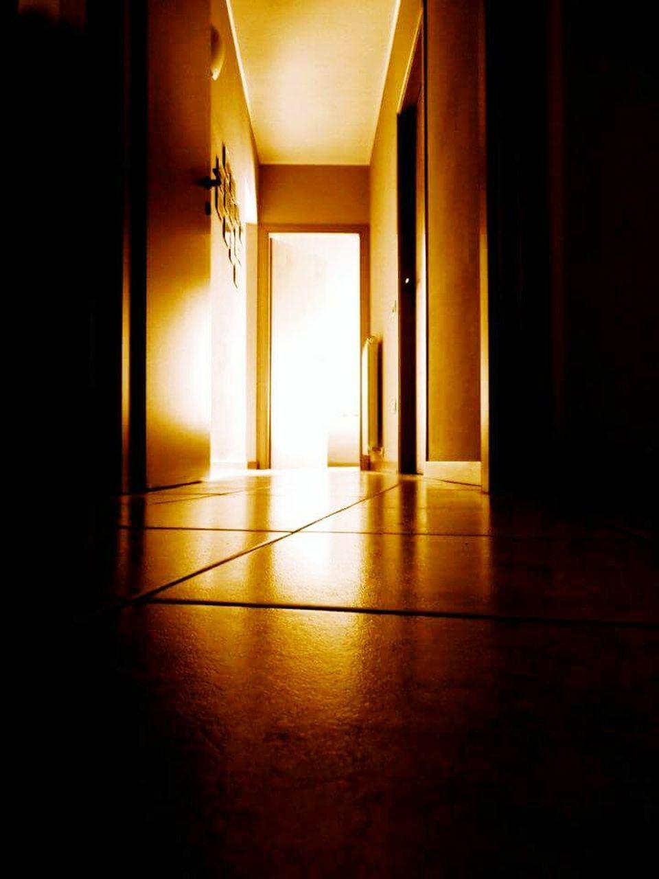indoors, home interior, window, illuminated, room, domestic room, house, lighting equipment, dark, architecture, absence, curtain, built structure, flooring, empty, wall - building feature, darkroom, door, light - natural phenomenon, no people