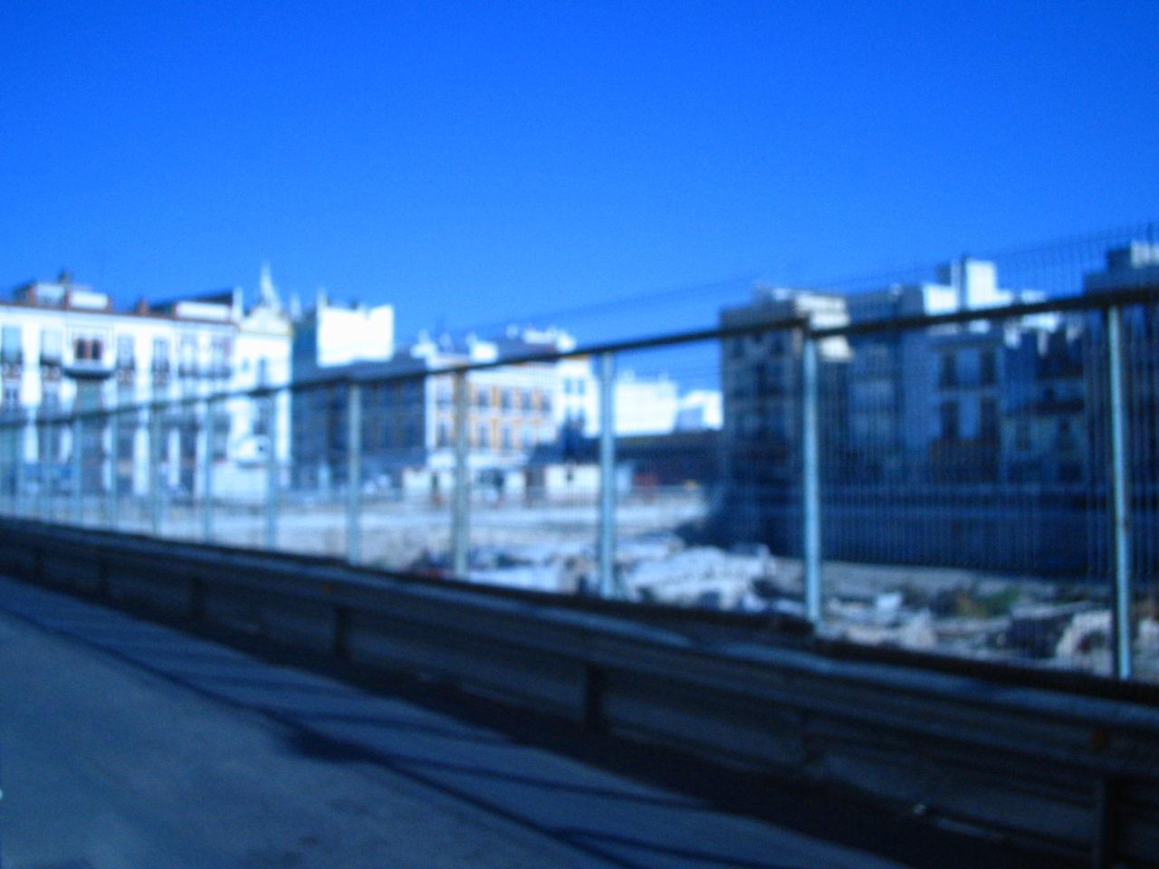 blue, transportation, rail transportation, built structure, architecture, railroad track, no people, train - vehicle, public transportation, building exterior, clear sky, day, outdoors, sky