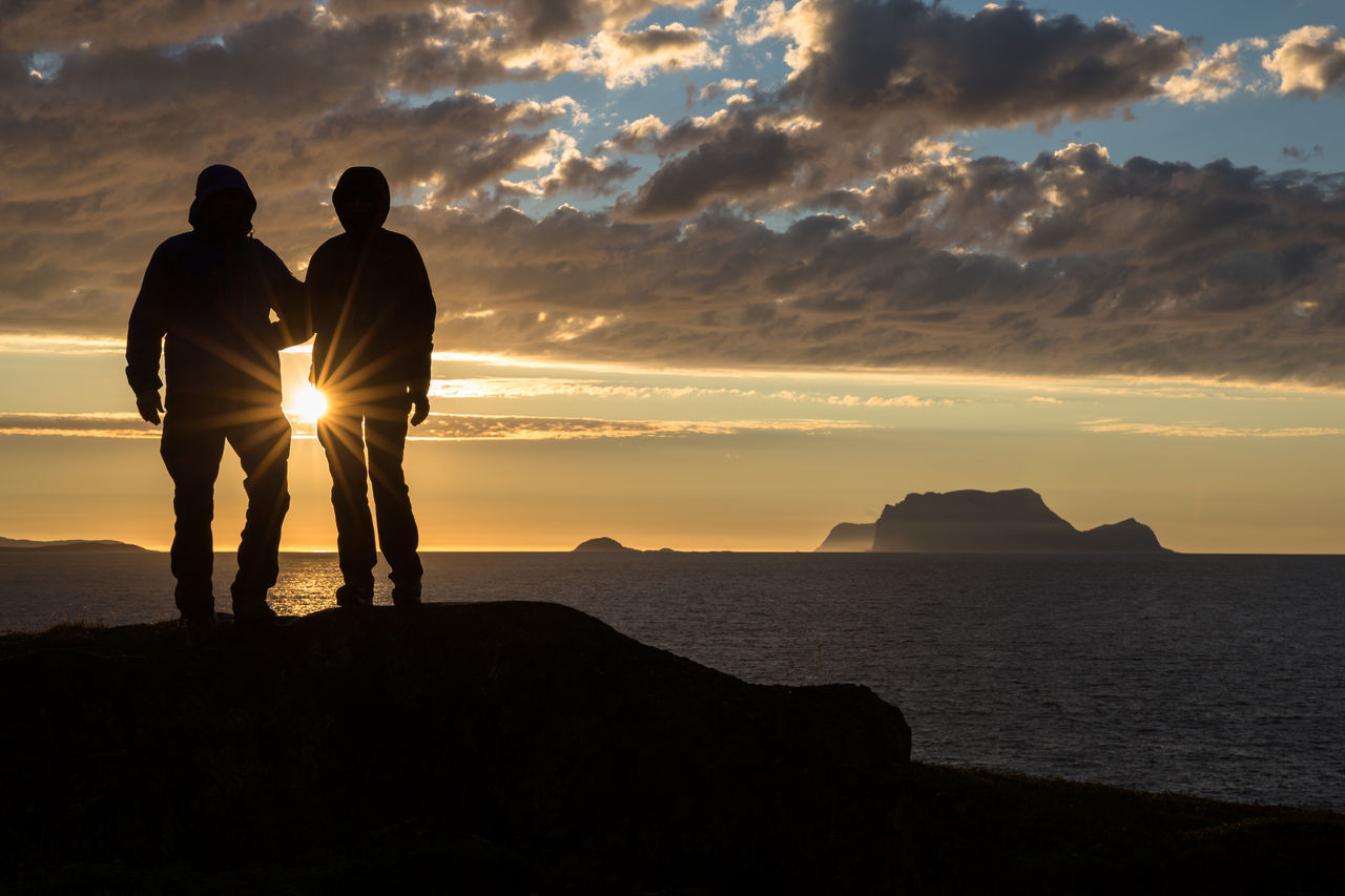 Adult Adults Only Beach Beauty In Nature Bonding Cloud - Sky Human Body Part Landscape Leisure Activity Lyngen Lyngen Alps Lyngsalpene Midnight Sun Nature Northern Norway Norway Outdoors People Scenics Sea Silhouette Sky Sunset Togetherness Two People
