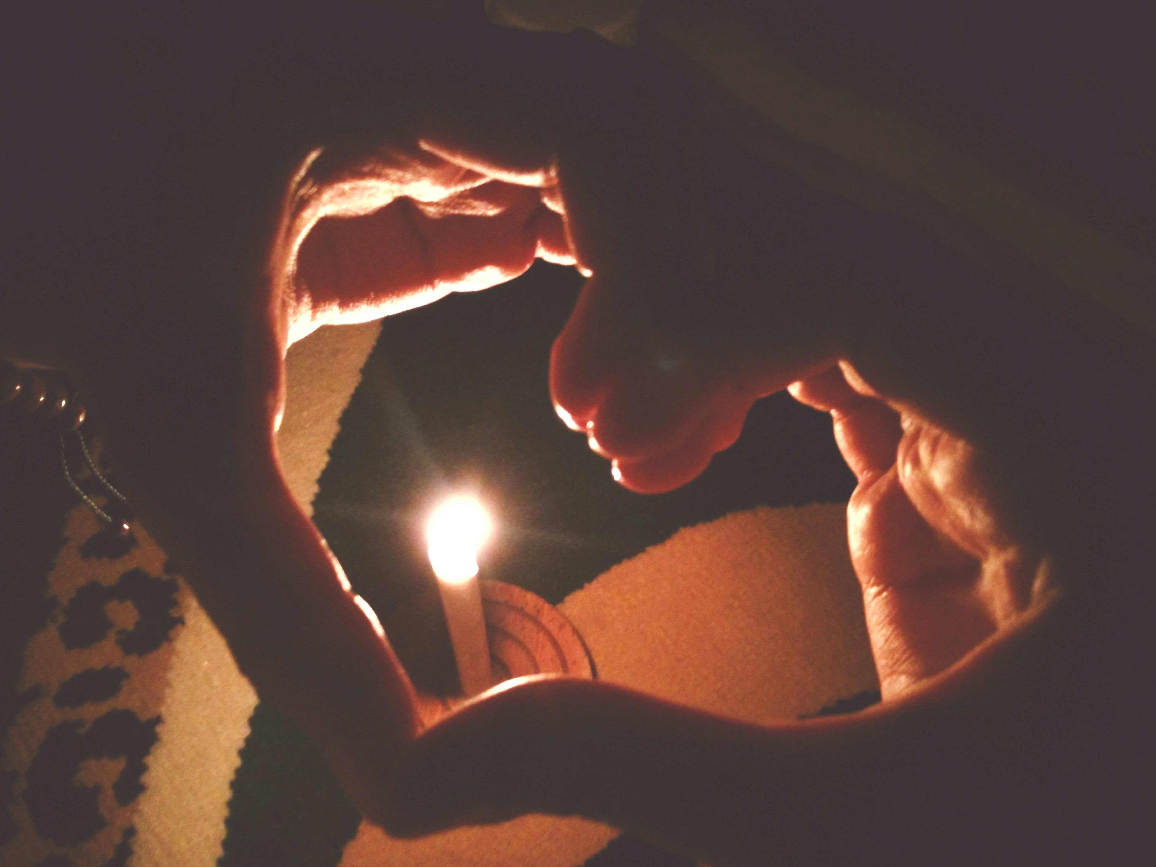 indoors, person, lifestyles, leisure activity, burning, flame, close-up, night, men, heat - temperature, part of, love, glowing, dark, fire - natural phenomenon