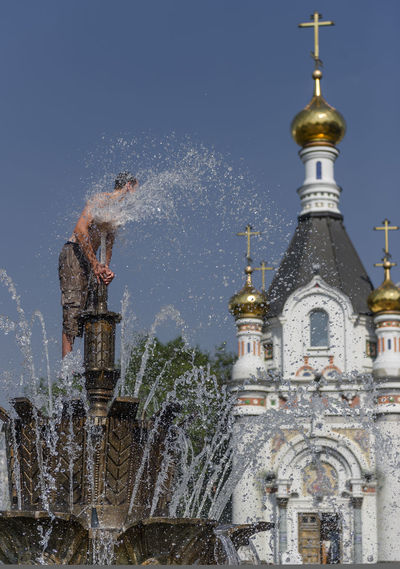 Russia, Yekaterinburg, fountains, heat, youth Architecture Blue Built Structure Capital Cities  City City Life Day Illuminated Nature No People Outdoors Russia, Yekaterinburg, Fountains, Heat, Youth Sky Tall - High Tourism Travel Destinations