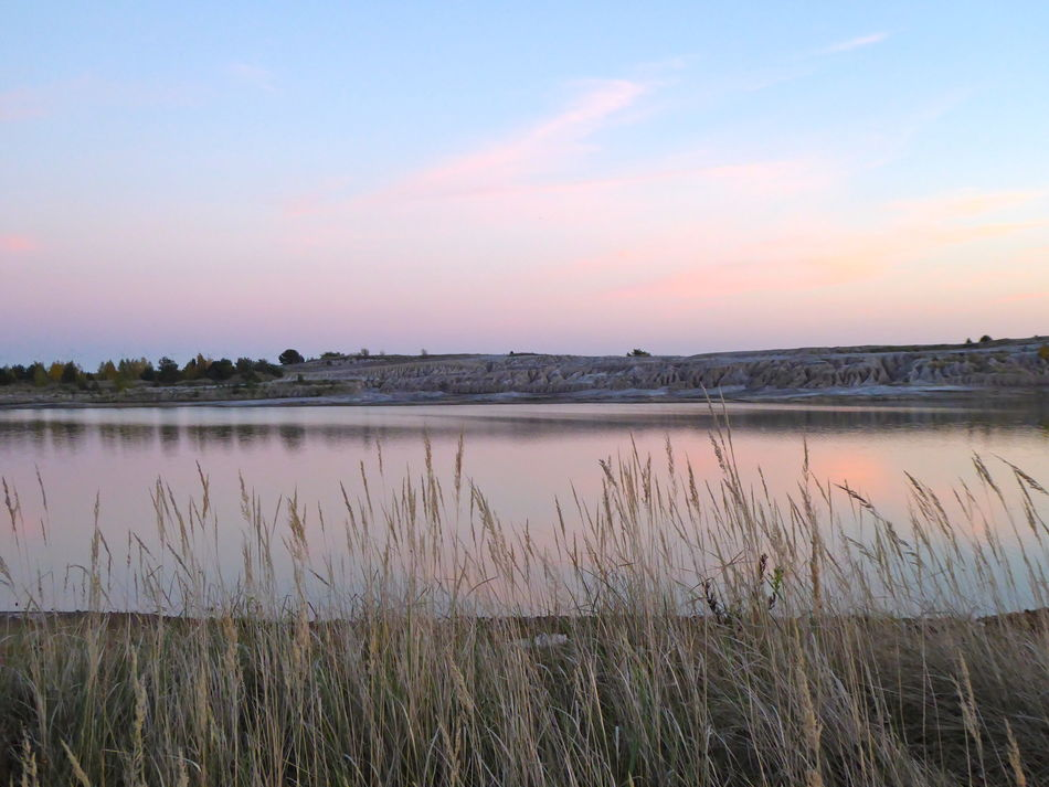 Beauty In Nature Dry Grasses Growth Lake Landscape Nature Outdoors Pastel Colors Peaceful Landscape Pink Sky Scenics Sky Sunset Tourist Destination Tranquil Scene Tranquility Water