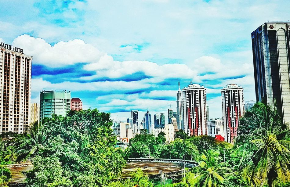 Cityscape City Skyscraper Urban Skyline Sky Building Exterior Travel Destinations Architecture Cloud - Sky No People Growth Outdoors Modern Tree Day Kuala Lumpur Citycenter KLCC Twin Towers Klcc 蓝天 蓝天白云 吉隆坡 双峰塔 市区 Adapted To The City Lieblingsteil Miles Away
