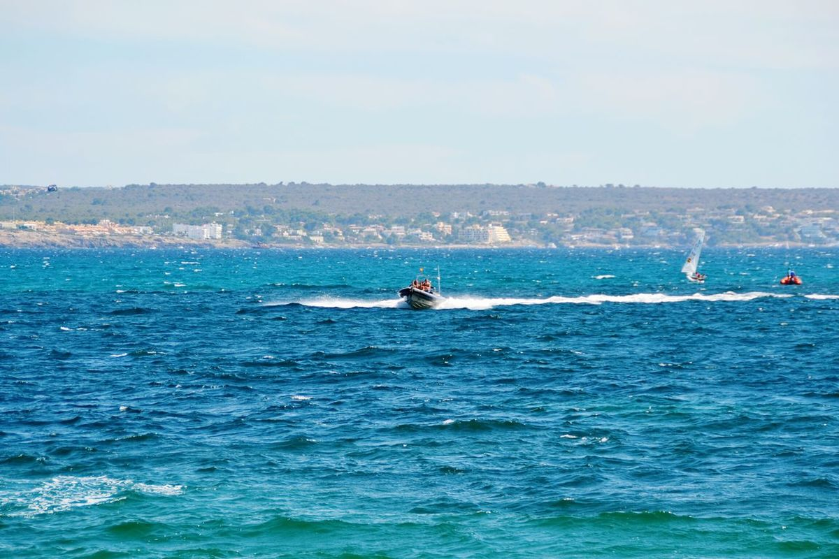 Sea Water Sport Outdoors Day Nature Aquatic Sport Adventure Sky Beauty In Nature People Motorboat Speed Motion Blue Real People Sea Life Vacations Travel Destinations Sunny Day Aquatic Sports Fun Beach Life Togetherness Sea And Sky