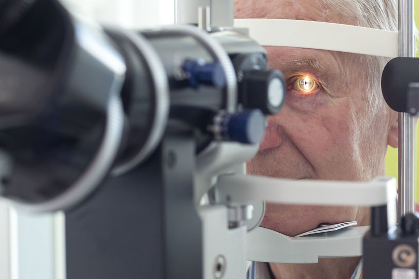 Eye examination at the slit lamp Cataract Córnea Diagnosis Doctor  Examination Eye Eye Doctor  Eye Examination Eyesight Health Lamp Laser Looking Man Oculist Ophthalmologist Ophthalmology Optometrist Optometry Patient Pupil Retina Senior Slit Lamp Test