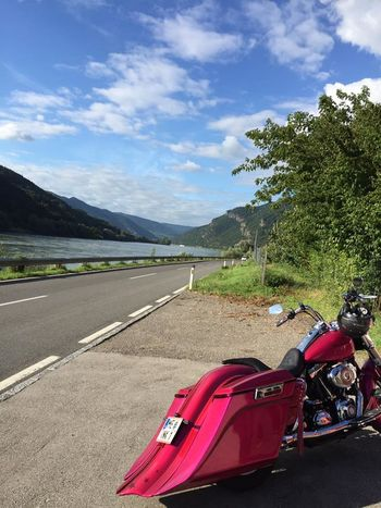 Auto Racing Baggerstyle Beauty In Nature Cloud - Sky Day Harleydavidson Land Vehicle Landscape Mode Of Transport Mountain Mountain Range Nature No People Outdoors Racecar Red Road Scenics Sky Sports Race Sports Track The Way Forward Transportation Tree