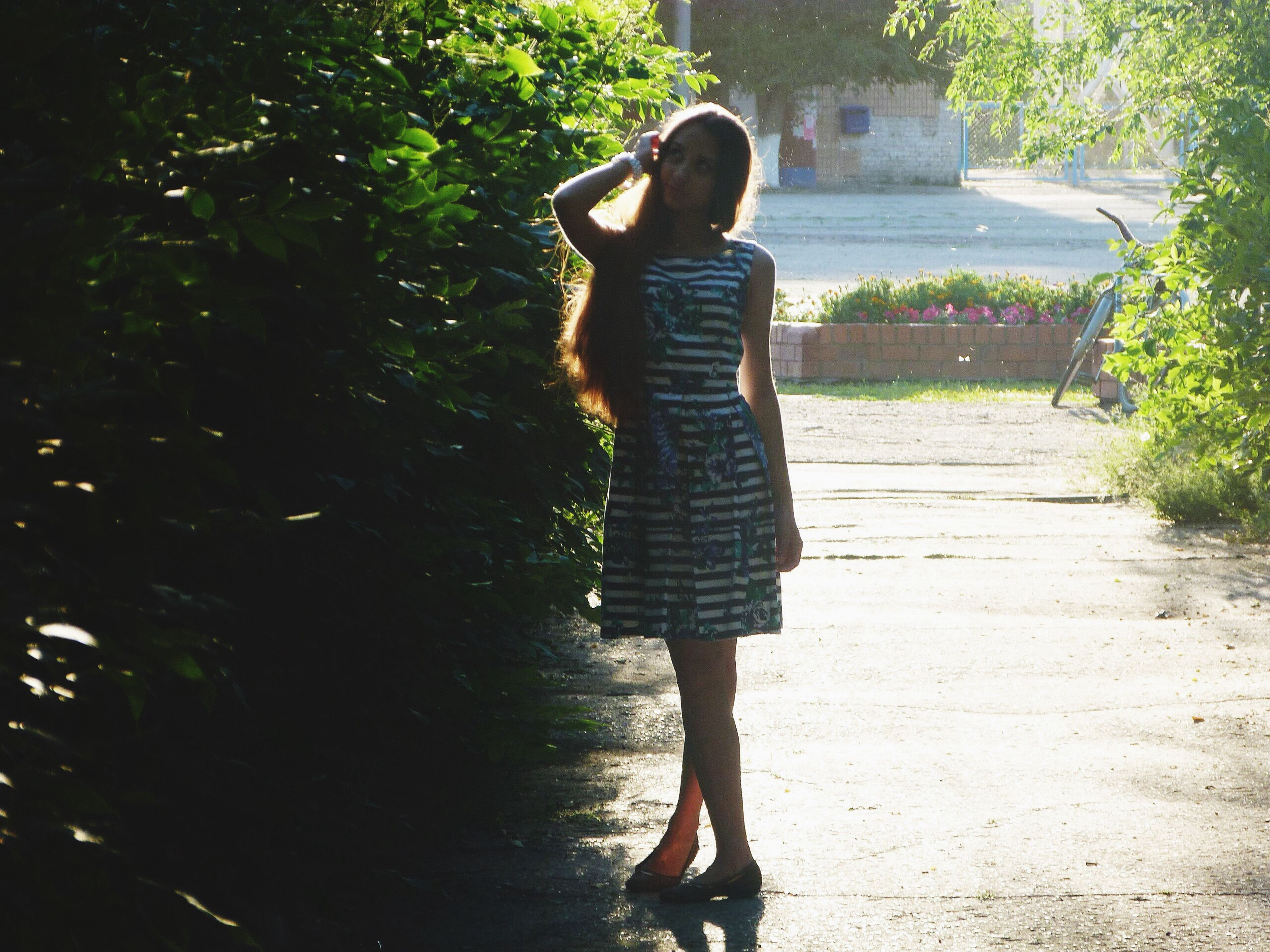 full length, casual clothing, lifestyles, leisure activity, standing, tree, person, rear view, young adult, sunlight, front view, young women, childhood, three quarter length, walking, outdoors, day, park - man made space