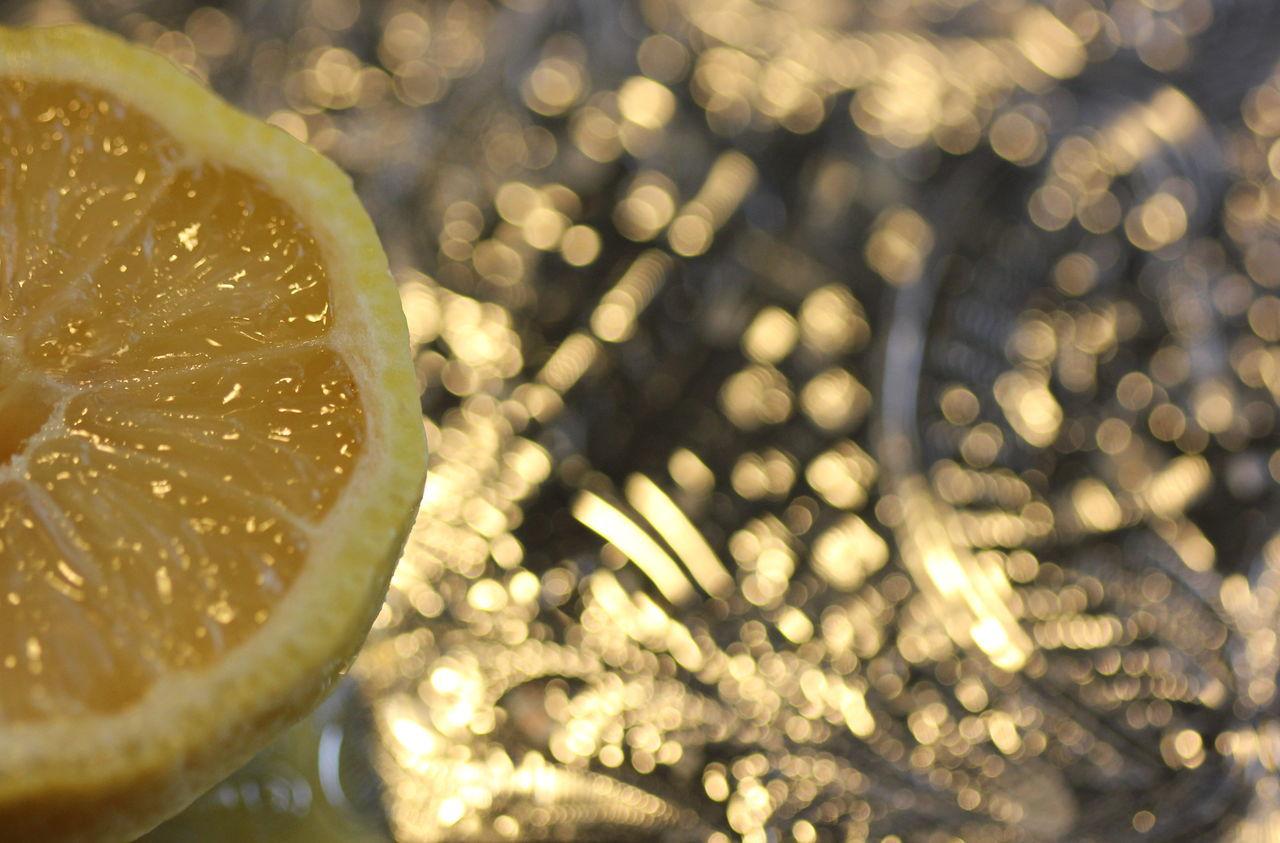 Close-Up Of Lemon Against Defocused Lights