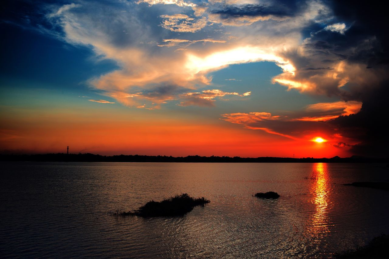 Sunset Sky Water Beauty In Nature Scenics Nature Orange Color Tranquility Waterfront No People Reflection Sea Tranquil Scene Cloud - Sky Silhouette Outdoors Day