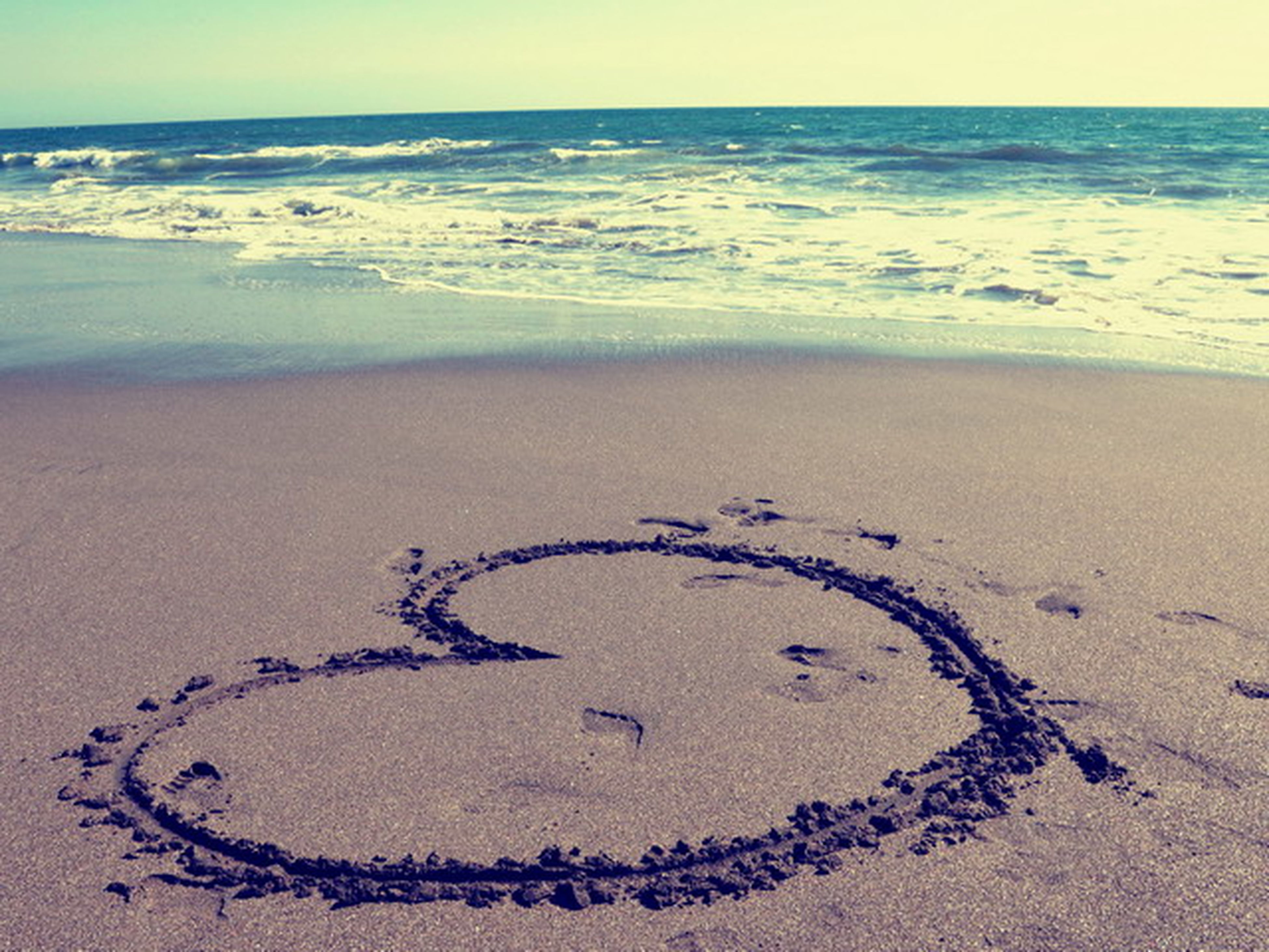beach, sand, sea, shore, water, horizon over water, text, western script, communication, tranquility, footprint, tranquil scene, scenics, heart shape, wave, nature, surf, beauty in nature, creativity, love