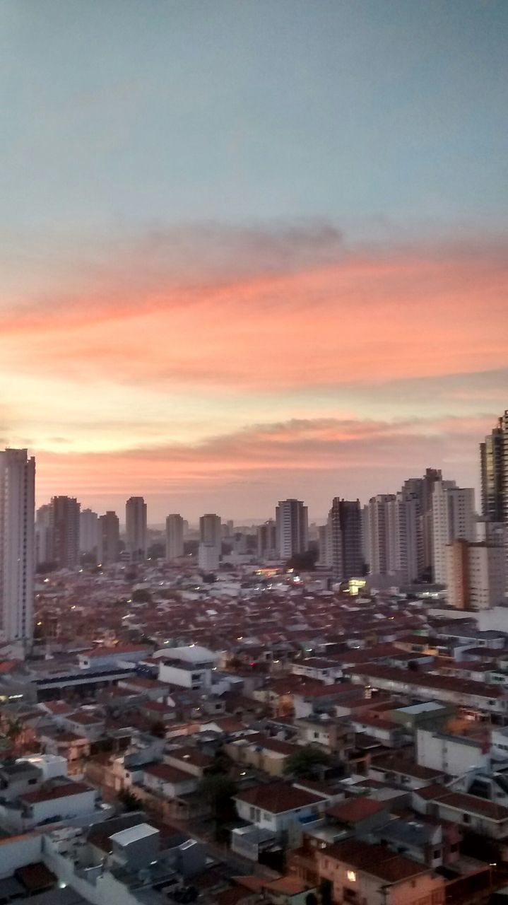 architecture, building exterior, cityscape, skyscraper, sunset, city, built structure, sky, no people, skyline, modern, tall, outdoors, travel destinations, urban skyline, day