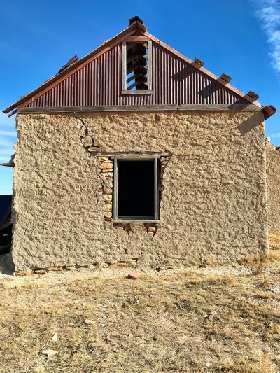 """""""Mystery Ranch No. 19"""" Window To The Soul. New Mexico Photography New Mexico Skies New Mexico Abandoned Buildings Abandoned Places Abandoned Stone Adobe Architecture Building Exterior Built Structure Window Outdoors No People Day Clear Sky"""