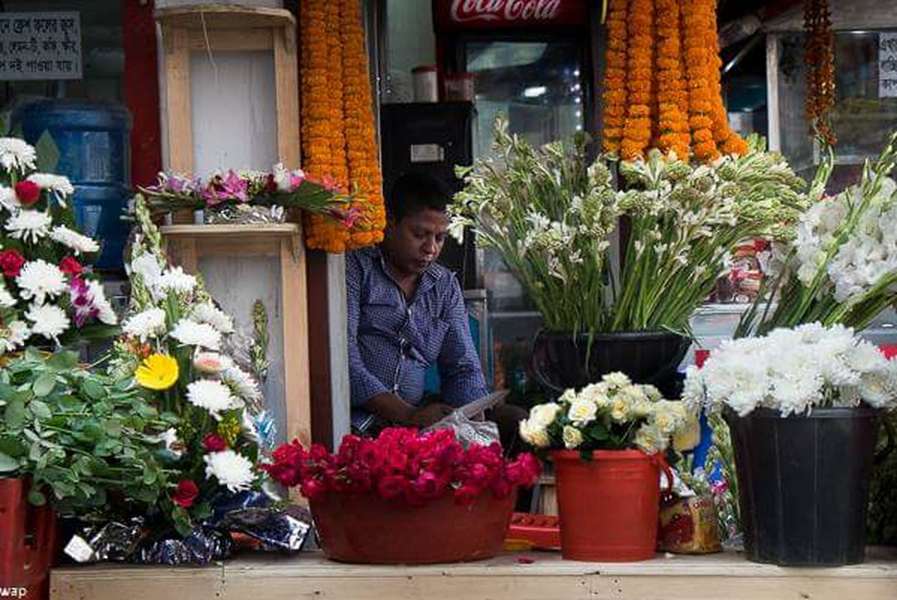 The florist and his thoughtfulness! Flower Flower Shop Selling Store Florist Business Freshness Bouquet Flower Arrangement Outdoors Variation