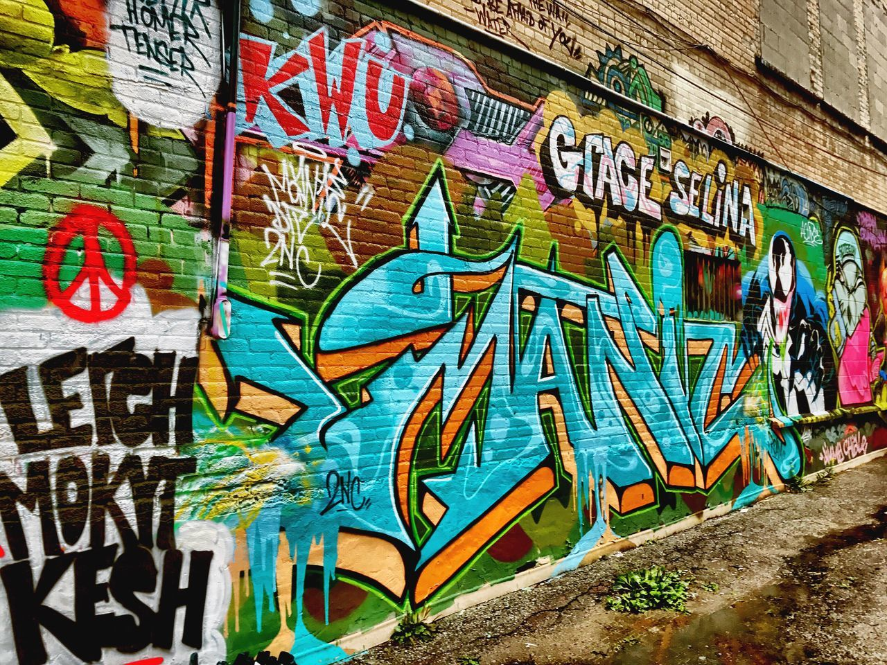 graffiti, street art, creativity, art and craft, text, multi colored, day, communication, outdoors, built structure, architecture, no people, close-up