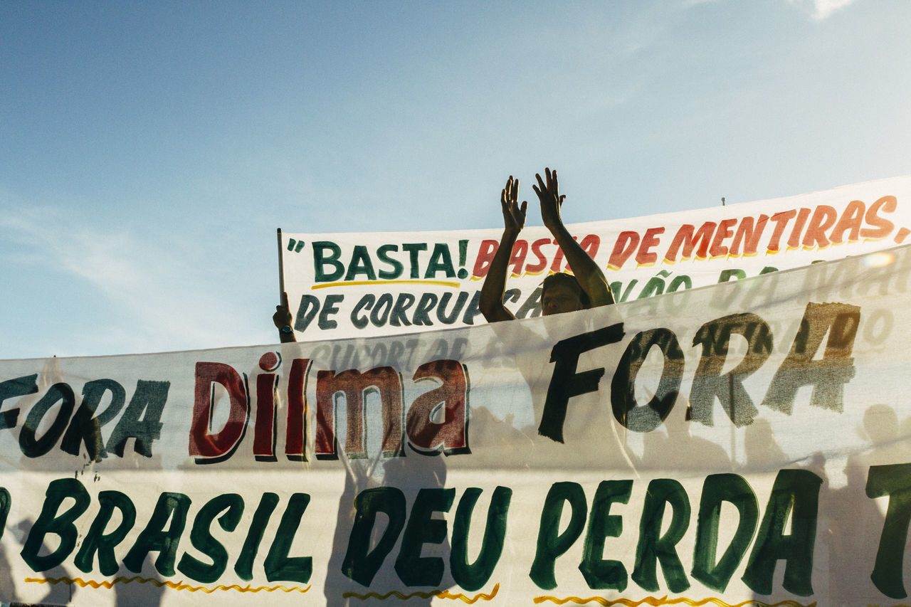 Capital Letter Clapping Hands Day Dilma Roussef Hands Up Information Information Sign Low Angle View Message No Corruption Outdoors Peacefull Protests Pose Presidential Impeachment Protests Protests In Brazil Ptsd Awareness Riot Sign Sky Sunny Day The Photojournalist - 2016 EyeEm Awards Fuji Astia