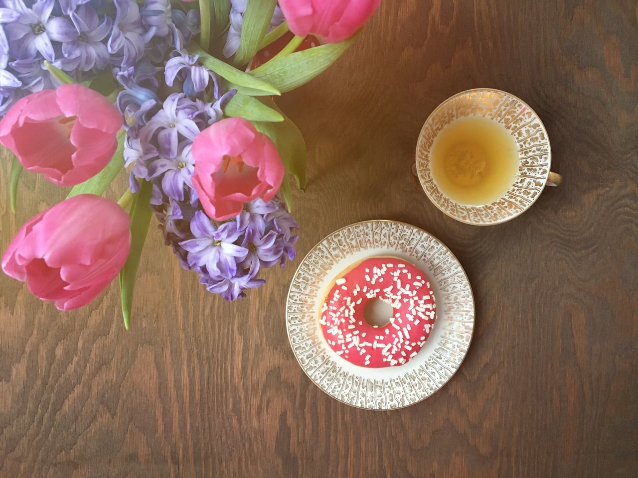 table, freshness, food and drink, indoors, flower, food, no people, high angle view, sweet food, close-up, beauty in nature, day, ready-to-eat