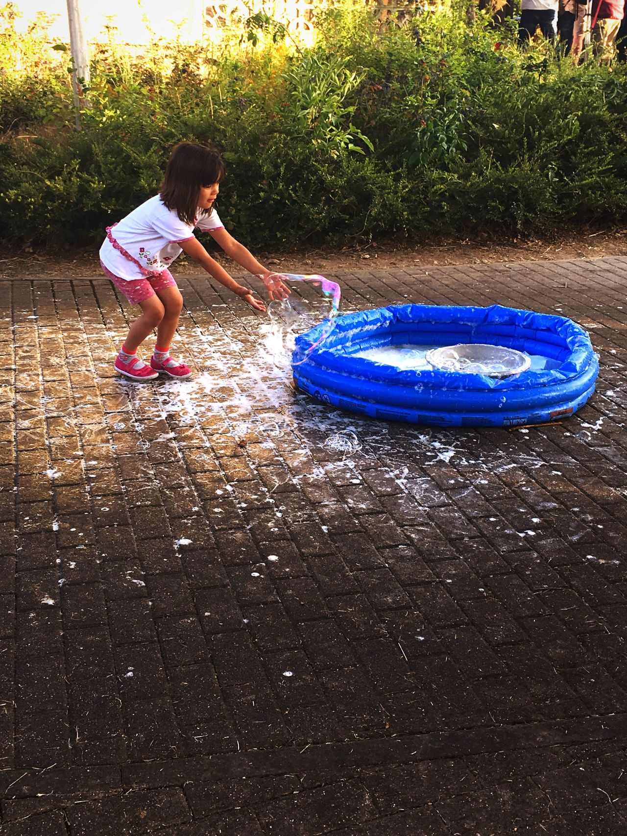 Young girl playing with a soap bubble from a small pool on the street Childhood One Person Full Length Water Garden Hose Casual Clothing Child Leisure Activity Real People Outdoors Playing People Day Dream Dreamcatcher Dreamer Daydreaming Daydream Lovely Great Atmosphere Kid Kids Being Kids Kids Having Fun Kids Playing Kidsphotography