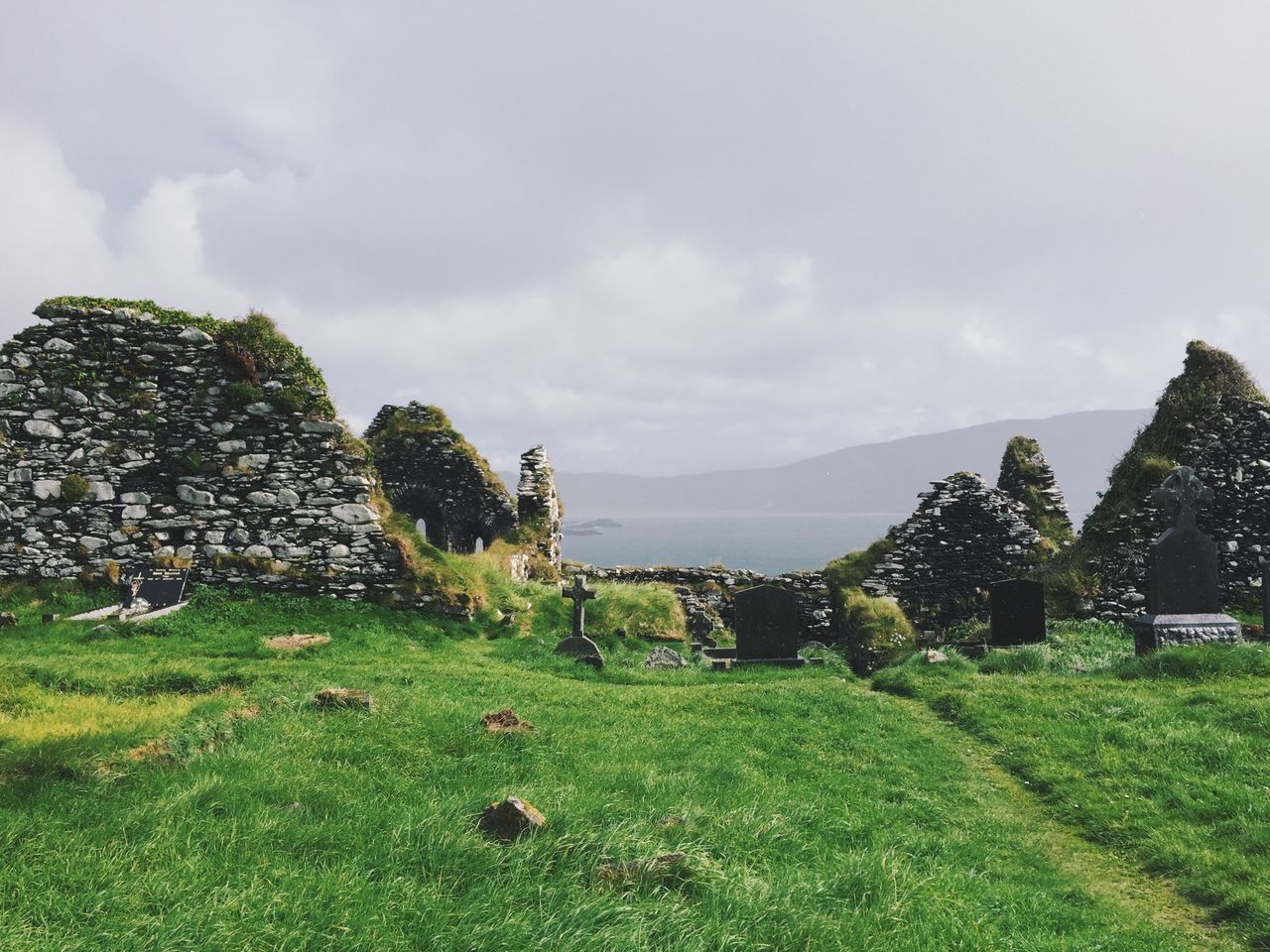 Graveyard Grass Beauty In Nature Nature Sky Growth Green Color Tranquil Scene Scenics Tranquility No People Tree Field Outdoors Landscape Cloud - Sky Day Built Structure Building Exterior Mountain Architecture Church Graveyard Celtic Ireland