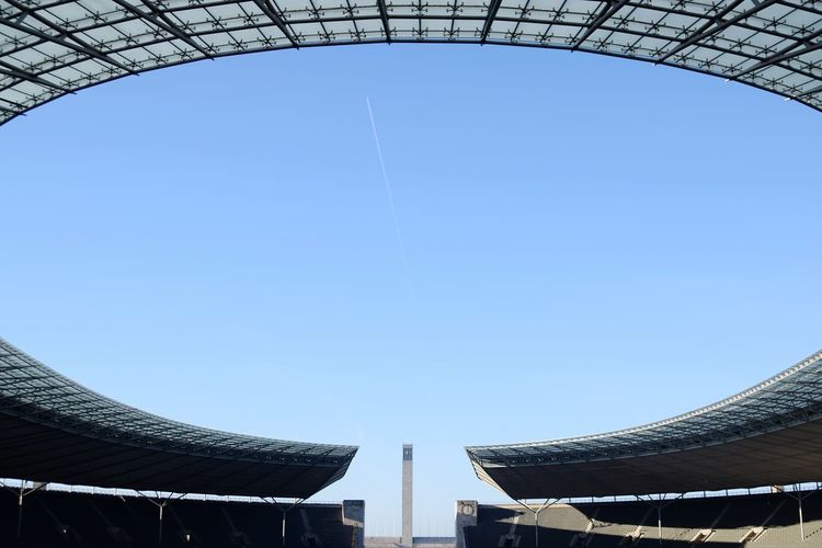 Olympic stadium Berlin Deutschland Germany Blue Sky Architecture Travel Destinations Clear Sky No People Outdoors Day Fussball Field Soccer Field Olimpic Stadium Olimpic Village Airplane Track Airplane Trails Olimpyapark Berlin Olympiastadion Latepost