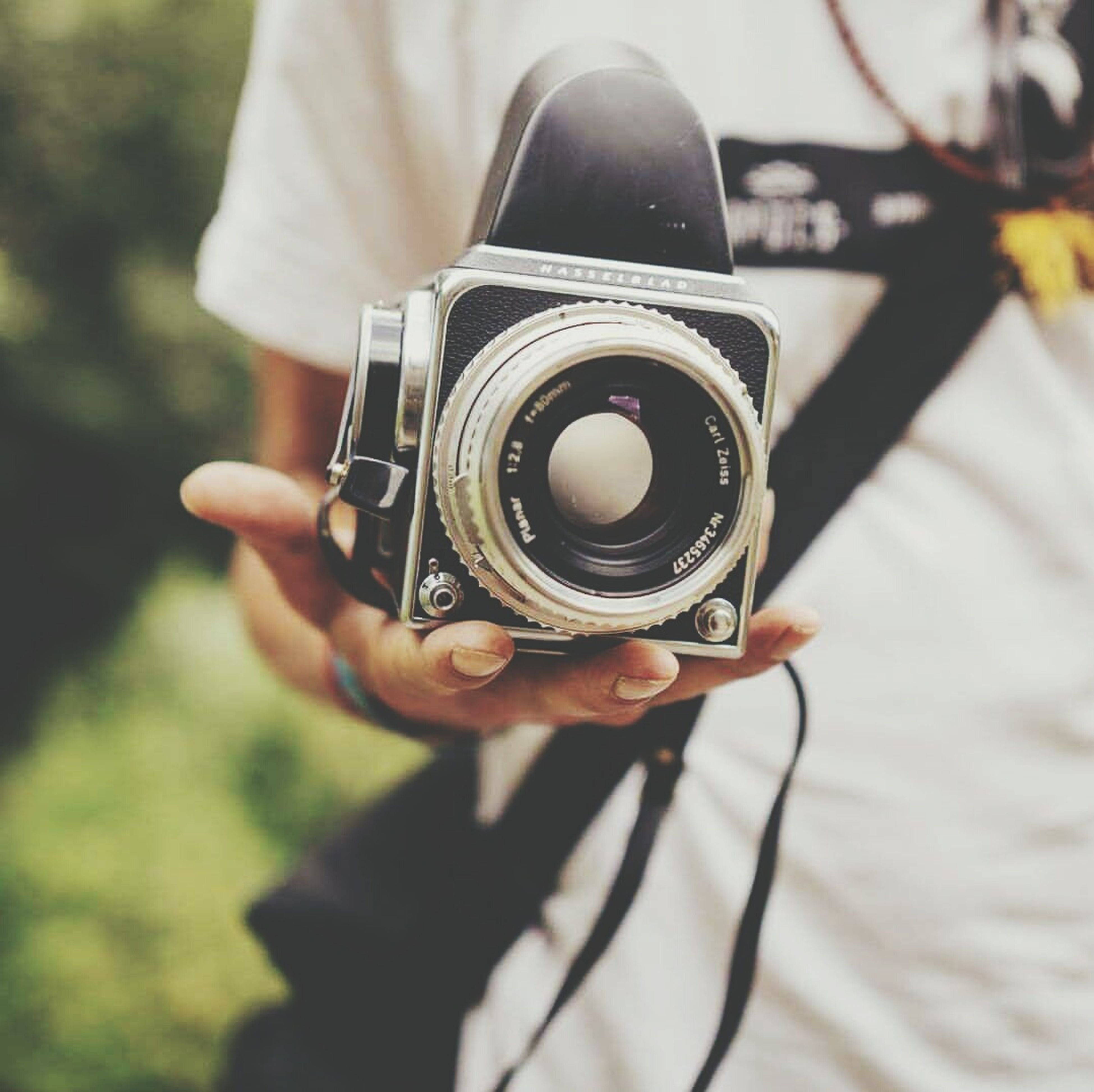 photography themes, camera - photographic equipment, technology, photographing, digital camera, holding, slr camera, photographic equipment, camera, photographer, old-fashioned, focus on foreground, connection, hobbies, professional occupation, person, memories