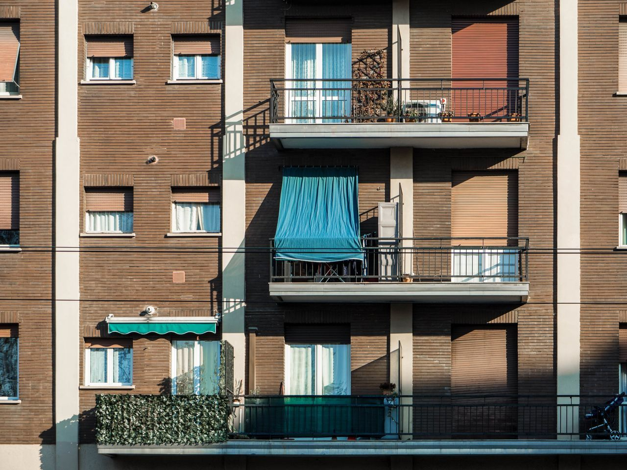 Apartment Buildings Apartments Architecture Awnings Balconies Balconies In The Building Blinds Brick Brick Building Brick Wall Building Building Exterior Building Exteriors Built Structure Condominium Day Facade Building Facades No People Outdoors Palace Railing Stroller Sunny Building Windows