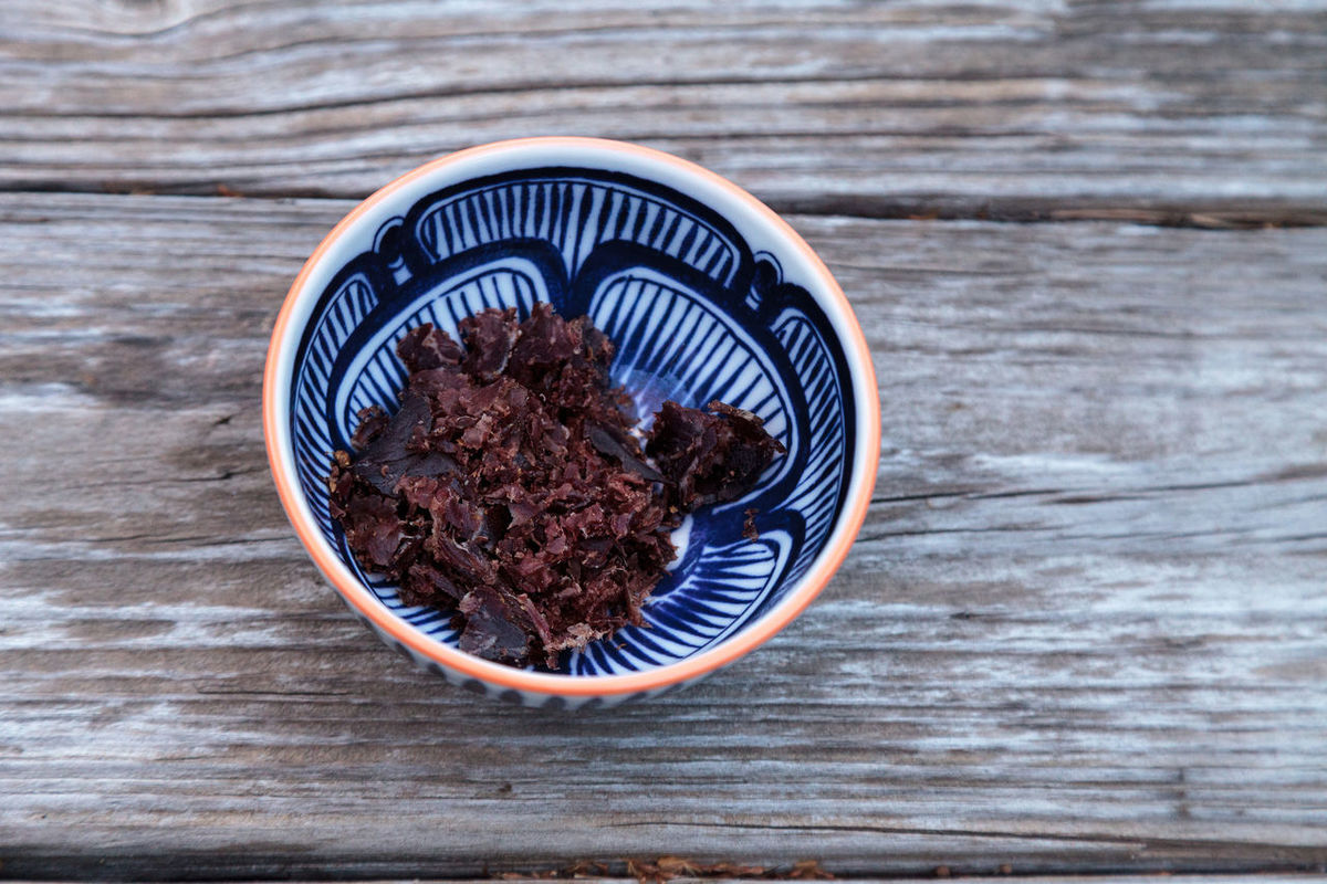South African beef biltong, cured meat in a blue and white patterned bowl on a rustic wood table. Beef Jerkey Beef Jerky Biltong Bowl Cured Meat Food Jerky  Meat Protein Rustic Snack South Africa South African Wood Table