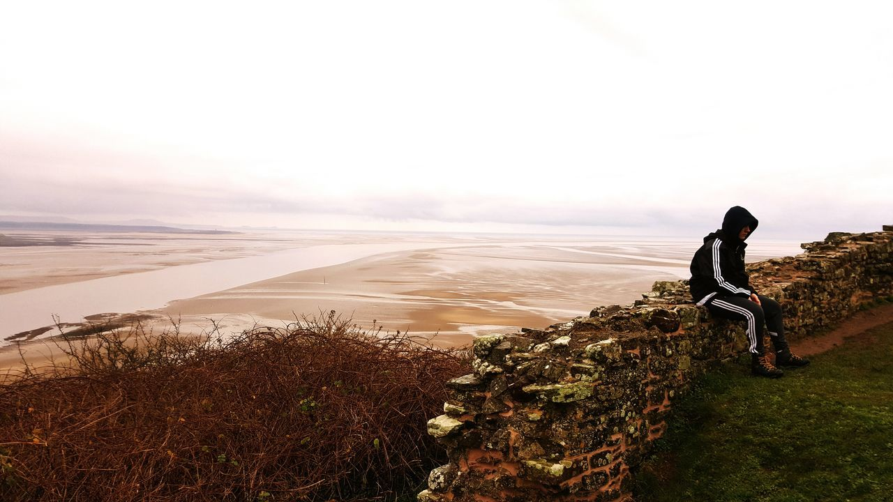 Quiet contemplation Beach Lonely Outdoors Sea Thinking Sky Castle Walls Llansteffan Wales View Beauty In Nature