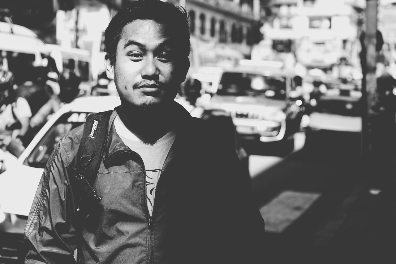 The Portraitist - 2017 EyeEm Awards City Street Street City Adult Young Adult Adults Only People City Life Portrait One Person Business Finance And Industry Blank Expression Beautiful People Elégance One Man Only Lifestyles Outdoors Business Only Men Well-dressed Eyeemnepal Shadow B&W Portrait Black & White
