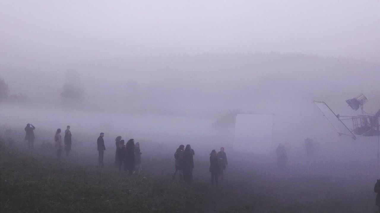 fog, foggy, weather, mist, nature, hazy, landscape, beauty in nature, winter, scenics, cold temperature, tranquility, real people, men, field, outdoors, sky, day, large group of people, mountain, people