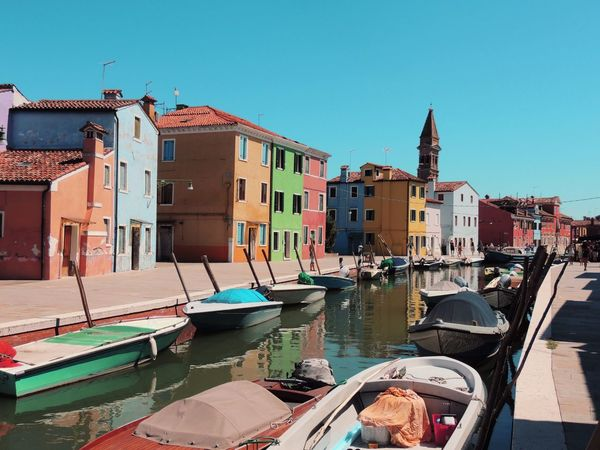 Venice Venice Building Exterior Architecture Built Structure Clear Sky House Sunlight Blue Transportation Outdoors Moored Nautical Vessel Residential Building No People Day City Water Sky Venedig Gondeln Murano Burano, Italy Burano, Venice Burano Color