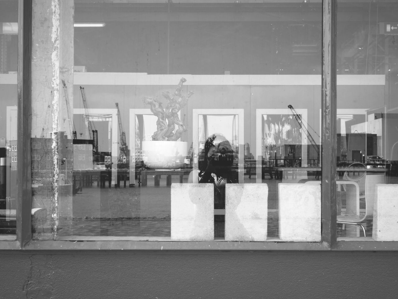 Woman Photographing Through Camera Reflecting On Glass Window